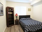 Queen bed and bookshelf with side table storage