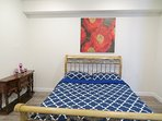 Queen bed with balcony and private restroom