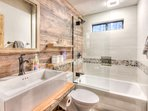Bathroom 1 is located downstairs and features a shower/tub combo