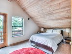 The Master bedroom is located upstairs and features a queen bed with a private balcony