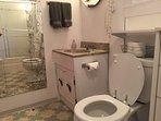 Bathroom with full wall mirror