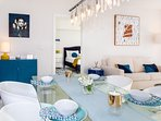 Living room, original art paintings, sofa is queen size bed