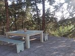 Outside wooden sitting area, BBQ dining table.