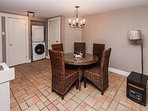 indoor dining area with washer/dryer in background