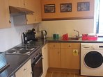 Owl kitchen with microwave, fridge, toaster, oven & hob, washer/dryer, kettle and coffee maker
