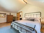 Just off the loft lies a queen bed inside guest bedroom #3, perfect for families.