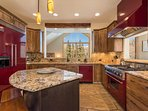 Enjoy the mountain views from within this bright and sunny kitchen, or turn on the tv (not pictured) for a bit of...