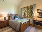 Guest bedroom #6 offers a queen bed and wooded views