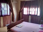 left hand air-conditioned bedroom with king size double bed