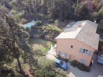 aerial view showing Lou Messugo front door, terrace, garden and pool