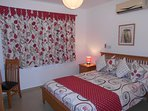 Comfortable air conditioned master bedroom