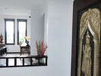 Our villa decor is a mix of Thai and a modern twist . We showcase works from local Samui artists .