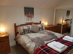 Spacious Double bedroom ample storage space and mirrored wardrobes to admire yourself in.