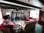 Living room with original inglenook and log stove