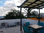 Rooftop terrace sitting area with Caribbean view