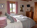 Master Bedroom in Ash Cottage.  King Size Bed with En-Suite Shower Room.