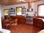 Another view of the spacious kitchen.