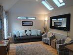 Lounge with large sofa bed access to courtyard garden via sliding doors.