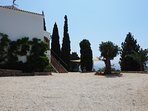 Ample parking area to the side of the villa.
