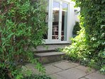 3 small steps leading up to your private garden area.