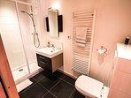 Ensuite bathroom with underfloor heating and heated towel rail