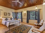 The spacious second bedroom overlooking the pine-forest behind the villa
