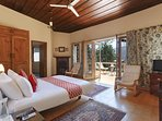 The Master bedroom which has a private balcony overlooking the Kasauli lights view