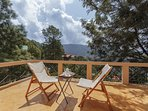The attached balcony to the master bedroom has beautiful views of the valley of Kasauli hills