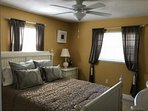 The master bedroom includes a comfortable, king size bed