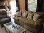 The comfortable living room can accommodate 4-5 guests