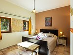 Master bedroom with a double bed & en-suite bathroom on the ground floor.