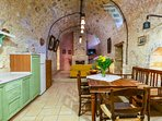 Indoor dining and fully equipped kitchen