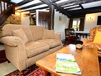 Furnished with British made sofa and Oak Antique furniture.
