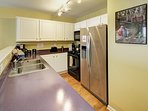 Fully stocked Kitchen with gas range, dishwasher