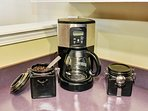 Coffee with locally roasted whole beans, electric grinder, drip pot and fixings.