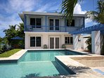 2 bedroom 2 story pool house across the pool deck from the main house for a total of 5 bedrooms!