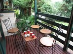 A very private, outdoor, covered deck to enjoy a drink, feed the wild birds and view the garden.