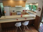 There's a 3 metre long meal preparation / servery / breakfast bar.
