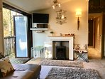 Luxury furnishings - Lounge with feature log-burner style electric fire and bi-folding doors