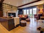 Lounge with log burner, tv and views