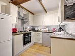 Refurbished kitchen that is fully equipped