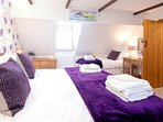 Top floor master bedroom includes additional single bed