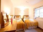 Twin beds in bedroom three