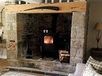 Woodburner set in large inglenook fireplace