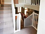 Carpeted staircase through rear door