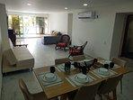 Zona de Comedor y amplia Sala de estar con 2 sofá camas