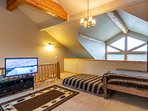 Vaulted ceilings and flat screen TV make it the perfect hangout zone
