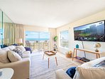 Gorgeous beach casual living room with views from the ocean. Large 65' TV to catch movies & shows!