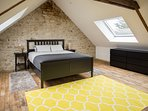 Newly refurbished attic bedroom with ensuite bathroom and large Velux windows