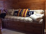 The cosy cabin bed on the balcony is a perfect place to curl up with a book , or for a 5th guest.